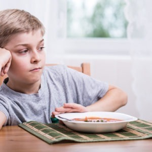 Boy refusing his dinner because he has OCD