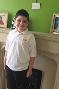 Joseph in his school uniform