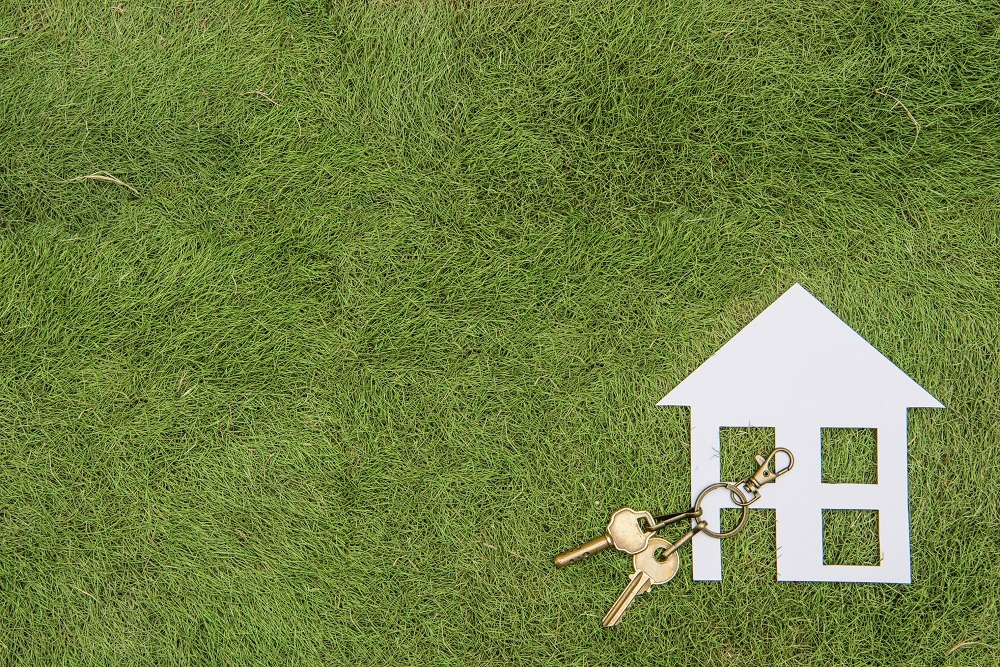 Paper house and key, home environment green living