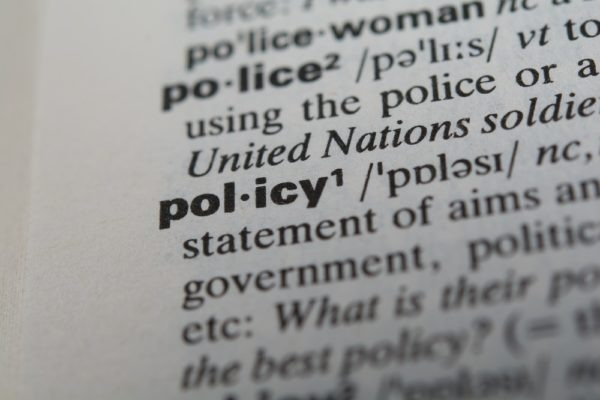 Definition of the word policy, close up