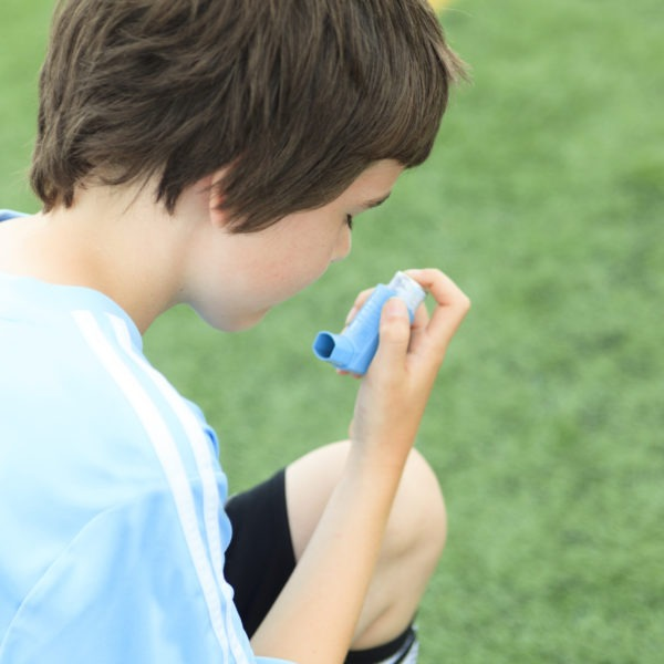 Child with asthma playing football