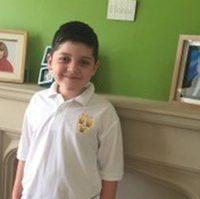 Joseph in his school uniform