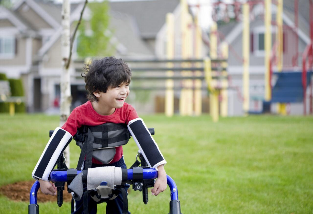 Disabled boy in walker