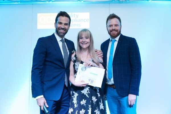 Nikki who blogs at Living with Lennon on stage with Gethin Jones and the representative from Room to Reward collecting her BAPS Award for best newcomer