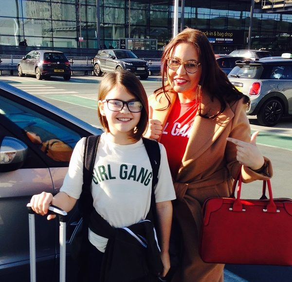 Carly and her daughter at the airport