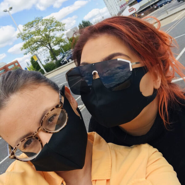 Carly and her daughter in their face masks
