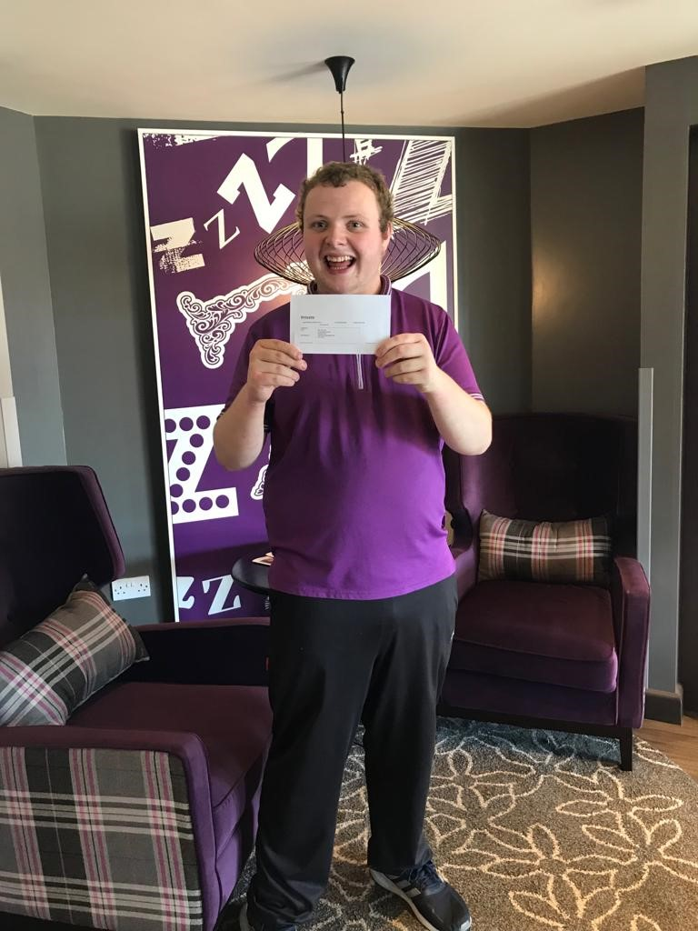 AG showing off his very first paycheck