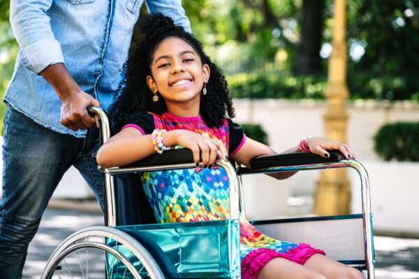 girl in wheelchair having fun outdoors