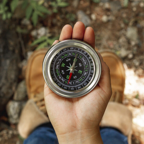compass in palm of hand